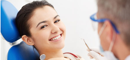 Image of smiling patient looking at camera at the dentist's