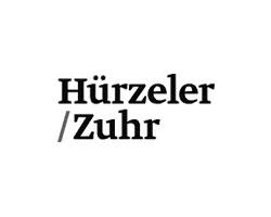 Logo Hürzeler/Zuhr - Clínica Dental Velázquez